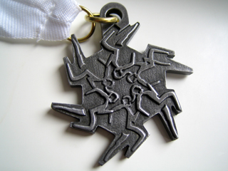 Finishers medal -- looks like a snowflake from afar